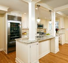 ceramic tile countertops kitchen island with columns lighting
