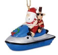 jolly santa on jet ski with reindeer