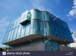 a modern building with curved glass walls galway city county