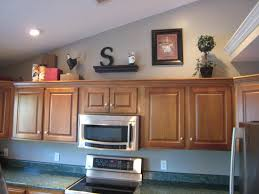 awesome ideas for decorating space above cabinets in kitchen 65 in