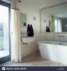 Large Mirrors For Bathrooms Large Mirror Above Modern Bath In Small Modern Bathroom With Stock