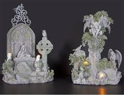 haunted cemetery with gargoyle figurines cemetery halloween