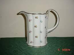 i godinger co rosebud i godinger co rosebud 8 1 2 pitcher stamped white various
