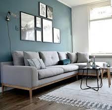 décoration canapé déco salon mur bleu canapé gris chiné applique style baladeuse