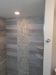 bathroom floors the latest trends tile for your home master shower with shelves rectangle wood look tiles and pebble