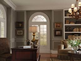 modern colonial office room with white arched window and antique