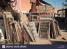 window frames for sale in a second hand market in marrakesh