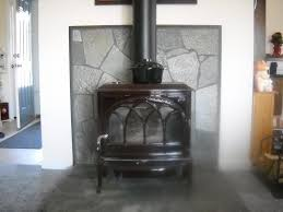 furniture appealing jotul wood stove before white stone wall and