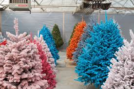of colored trees flocked in different colors stock