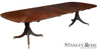 large oval mahogany double pedestal dining room table with a large regency classical double pedestal mahogany dining room