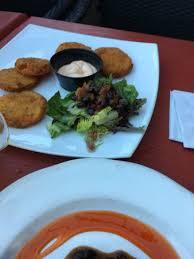 cuisine alligator alligator kabob fried green tomatoes satisfaction plate bread