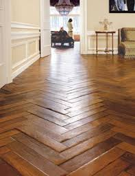 the colour of these beautiful hardwood floors in a chevron