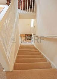 stairway to basement in home interior with wood paneling stock