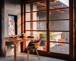 bureau beton ciré design interieur coin bureau meubles bois fauteuil patchwork murs