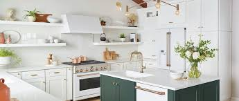blue kitchen cabinets with copper hardware the kitchen trend mixing metals café lifestyle