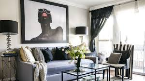 designer transforms one bedroom into chic home for herself and