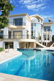 elegant pool design inspiration with blue water brown deck and