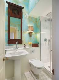 Tiny Bathroom Sinks by White Pedestal Sink And Mounted Toilet Installed In The Small