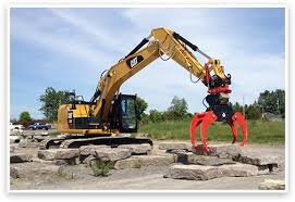 cat excavator rental with a rototilt indexator greely sand