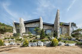 the layers serene rustic retreat with stone walls blends into the