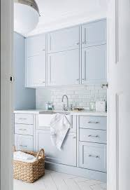laundry room floor cabinets blue laundry room cabinets with white subway tiles transitional