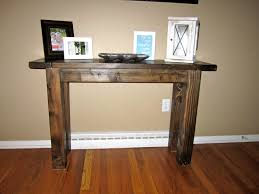 nice barn wooden entryway table with artwork pictures frame decors
