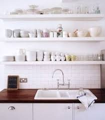 organize apartment kitchen tips for organizing your open shelving apartment therapy