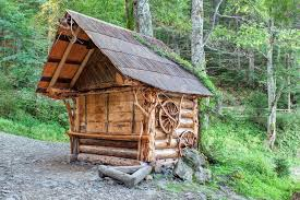 traditional wooden house in the carpathian forest stock photo