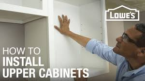 Hanging Upper Kitchen Cabinets by How To Hang Cabinets Youtube