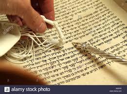 torah yad hebrew torah scroll with silver yad pointer and prayer shawl