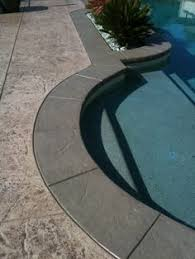 add interest to concrete patio and define outdoor spaces