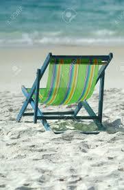 Chairs On A Beach Green Lawn Chair On A Sunny Beach Facing The Ocean Shallow Depth