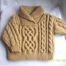 mustard sweater design with braided pattern