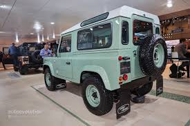 land rover says goodbye to the defender in geneva with 3 special