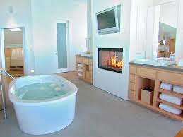minimalist bathroom design with gas fireplace and small white