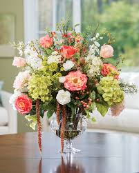 stylish decorating with silk flower centerpieces at petals