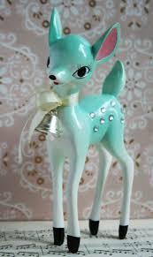this aqua deer ornament is a reproduction of a vintage
