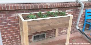 Planter With Legs by Remodelaholic Build An Elevated Planter Box And Save Your Back