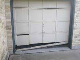 wood composite garage doors damaged bottom section on an old wood door u2014 cornell garage doors blog