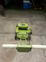 restored lawn boy 2 cycle lawn mower and small engine bob is