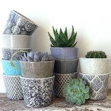 blue and white aged ceramic round pot rounding ceramic flowers