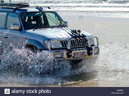 toyota 4wd toyota 4wd suv with fishing rods and surfboard mounted on hood and