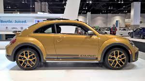 gold volkswagen beetle denver auto show