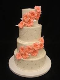 gorgeous lace effect wedding cake with hand piped details by party