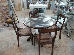 Round Dining Table With Glass Top Round Glass Top Table With Curving Brown Wooden Legs On The Cream