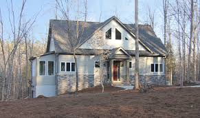 half stone house architecture using light grey exterior paint and