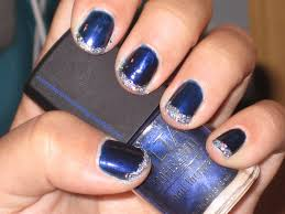 nails on nails on nails dark blue nails with glittery tips