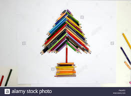 directly above view of christmas tree made from colored pencils on