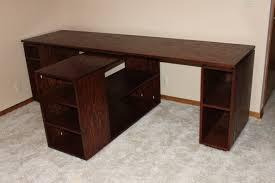 long wood two person computer desk with shelving unit separator of