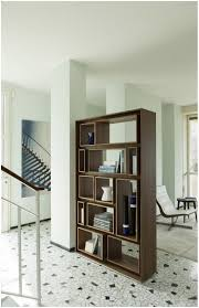 brown wooden bookshelves as room divider white painted wall